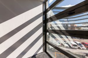 Interior view of glass windows looking into car park