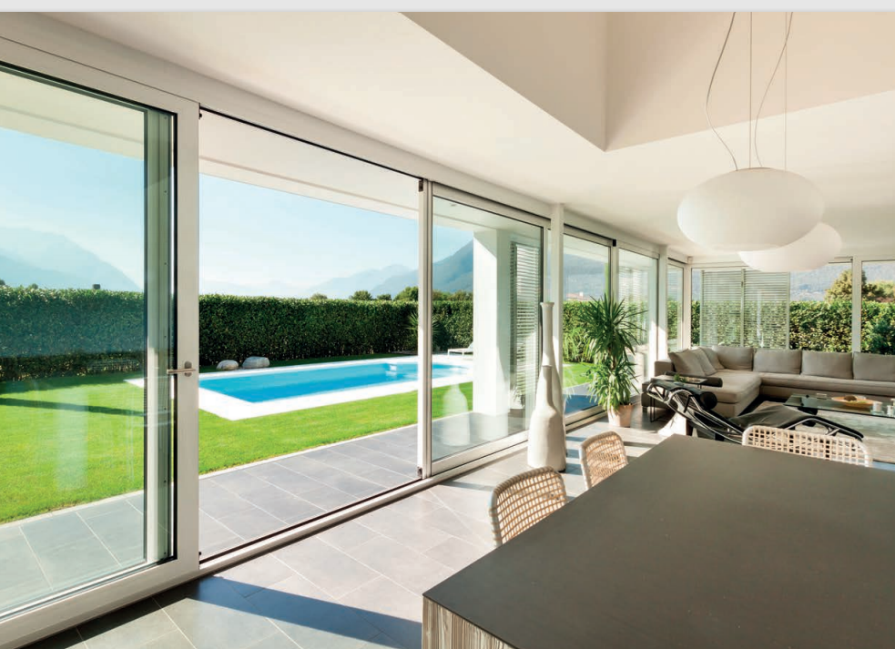 Sliding doors leading out to swimming pool