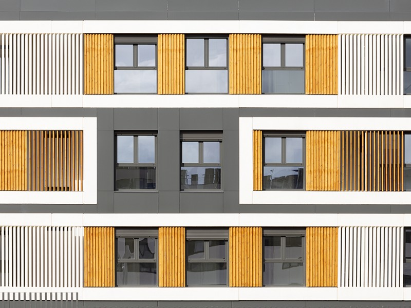 The KT51 tilt and turn windows in a block of yellow flats
